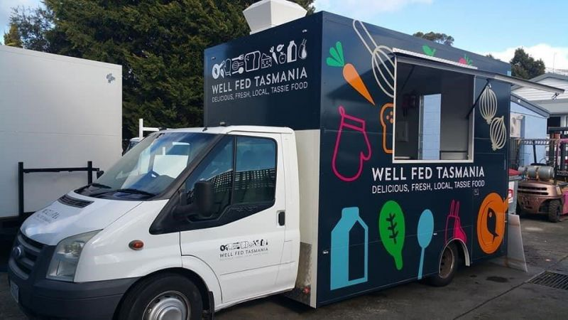 """Food Truck with the words """"well fed Tasmania.  Delicious, fresh, local Tassie food."""