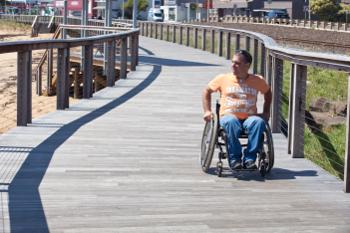 Man in wheelchair on boardwalk