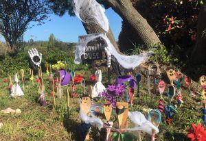 Halloween decorations in garden.